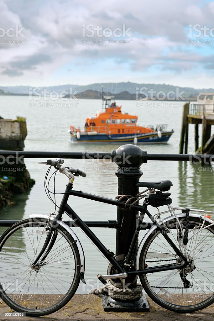 rescue lifeboat in cobh with bicycle stock photo
