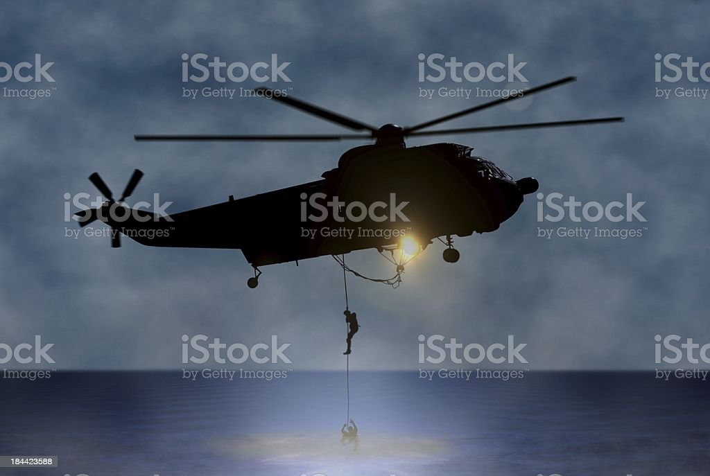 Rescue of the Person at Sea by Helicopter stock photo