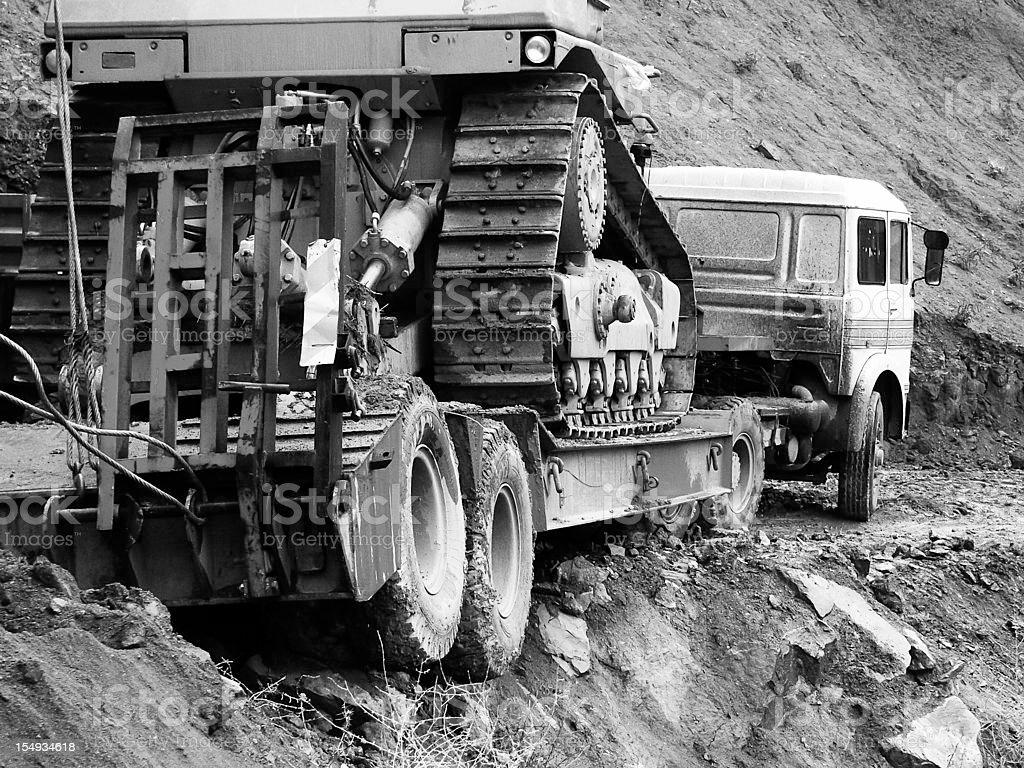rescue operation: bulldozer on the TIR near scarp royalty-free stock photo