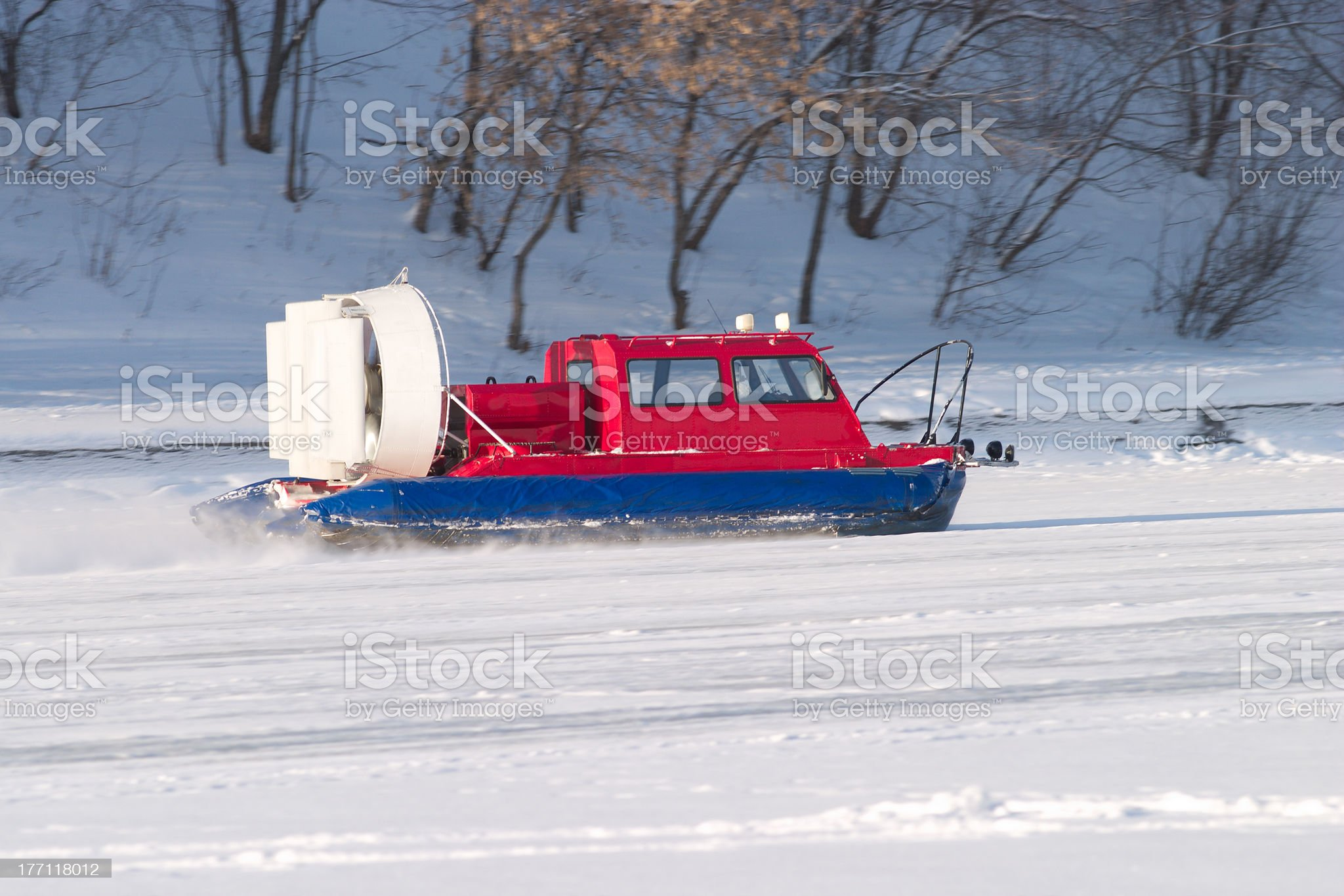 Rescue Service snowmobile patrol rides fast on frozen river royalty-free stock photo