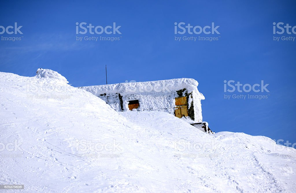Rescue station in snowy winter mountains stock photo