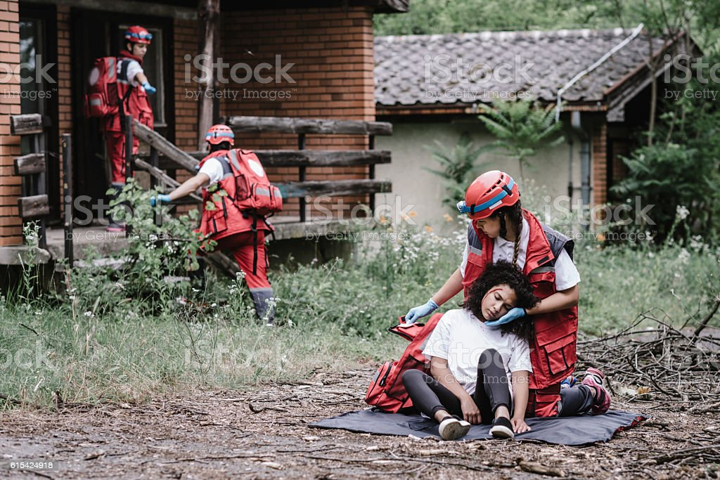 Rescue team helping injured female victim stock photo