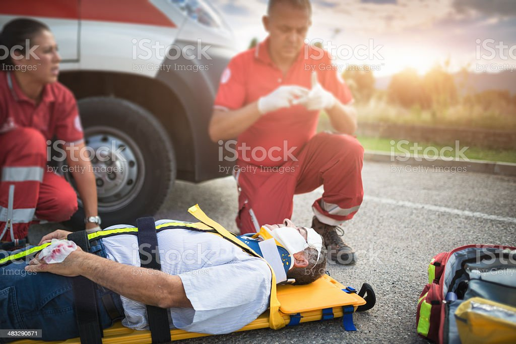 rescue team helping injured man royalty-free stock photo