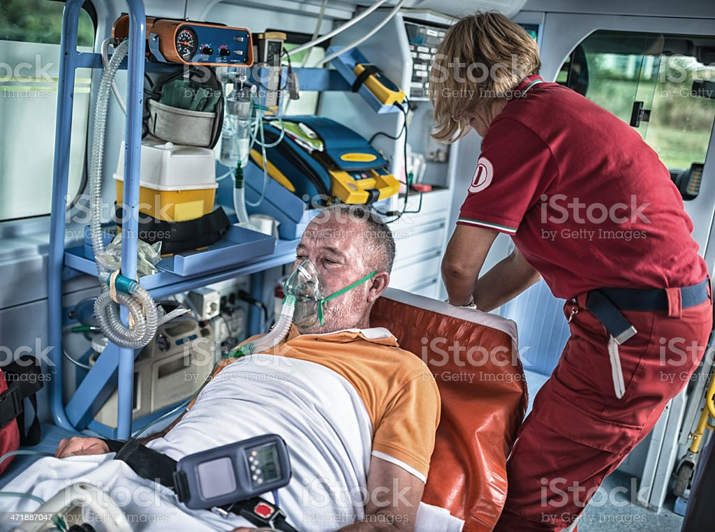 rescue team inside the ambulance royalty-free stock photo