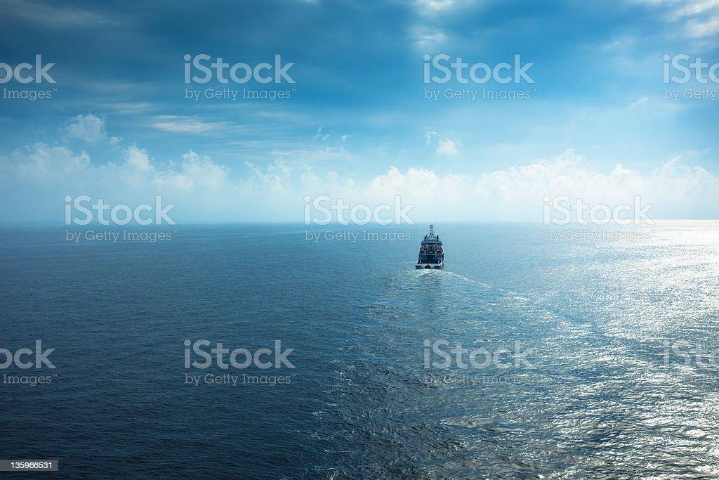rescue tug boat sailing in the yellow sea stock photo