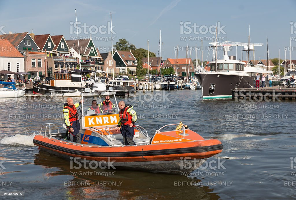 Rescue workers at lifeboat in harbor Urk, the Netherlands stock photo
