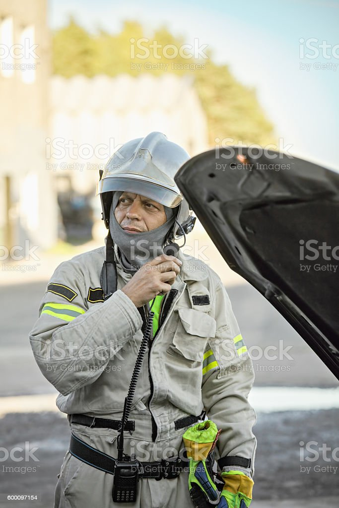 Rescuer at broken car stock photo