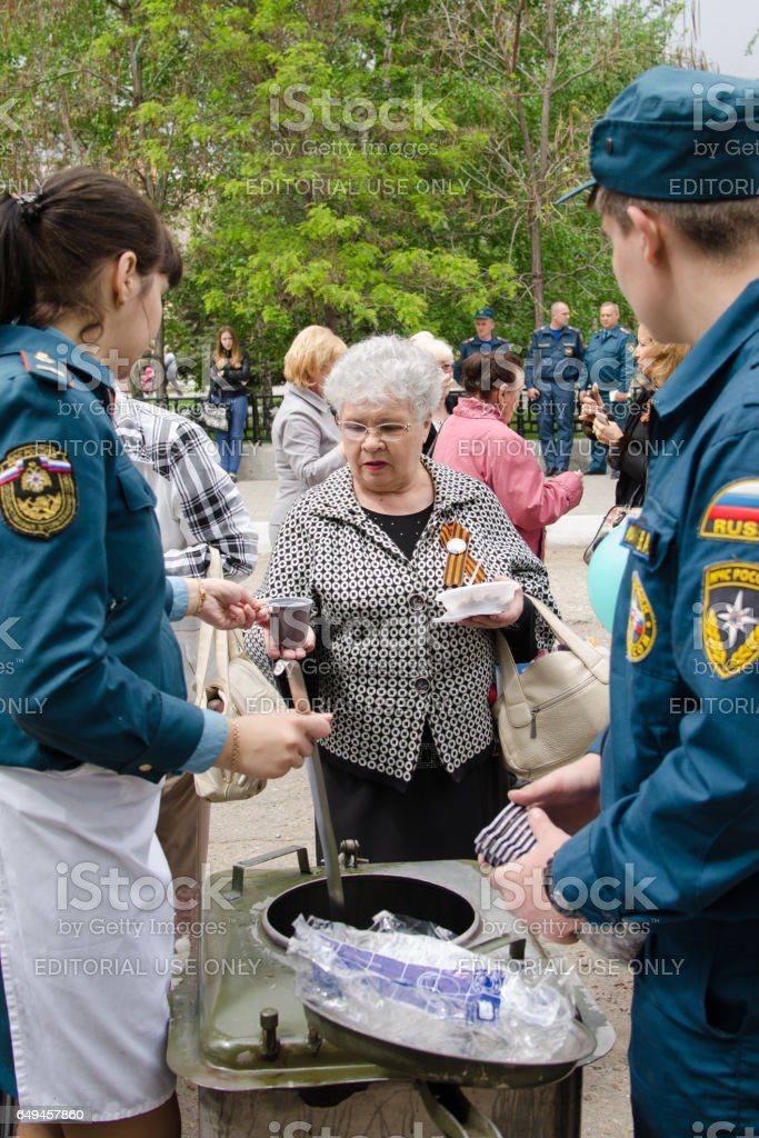 Rescuers are treated to tea with her grandmother field kitchen stock photo