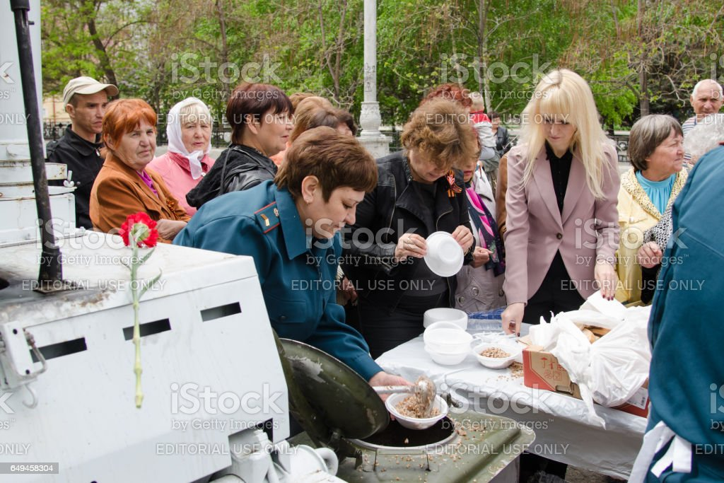 Rescuers treated passers porridge with field kitchen stock photo