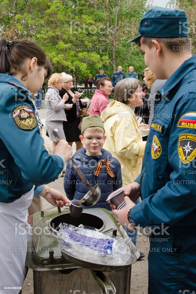Rescuers treated the boy with a tea field kitchen stock photo