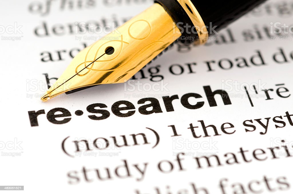 Research in a dictionary with a fountain pen royalty-free stock photo