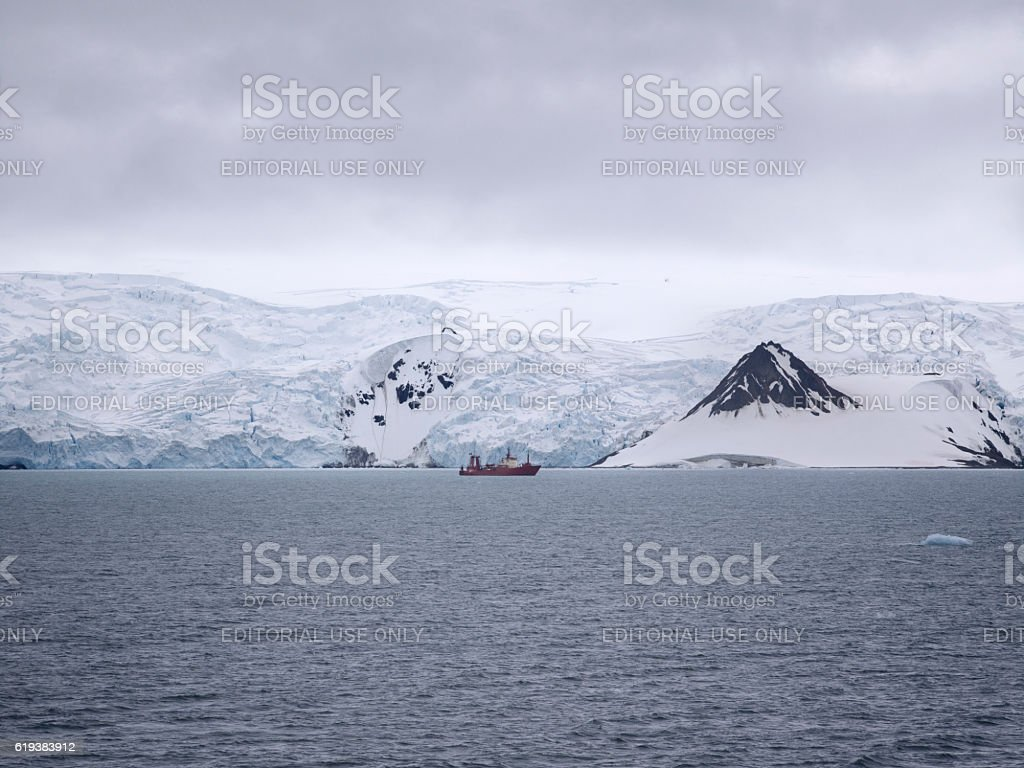 Research ship ancored at Admiralty Bay, King George Island, Antarctica. stock photo