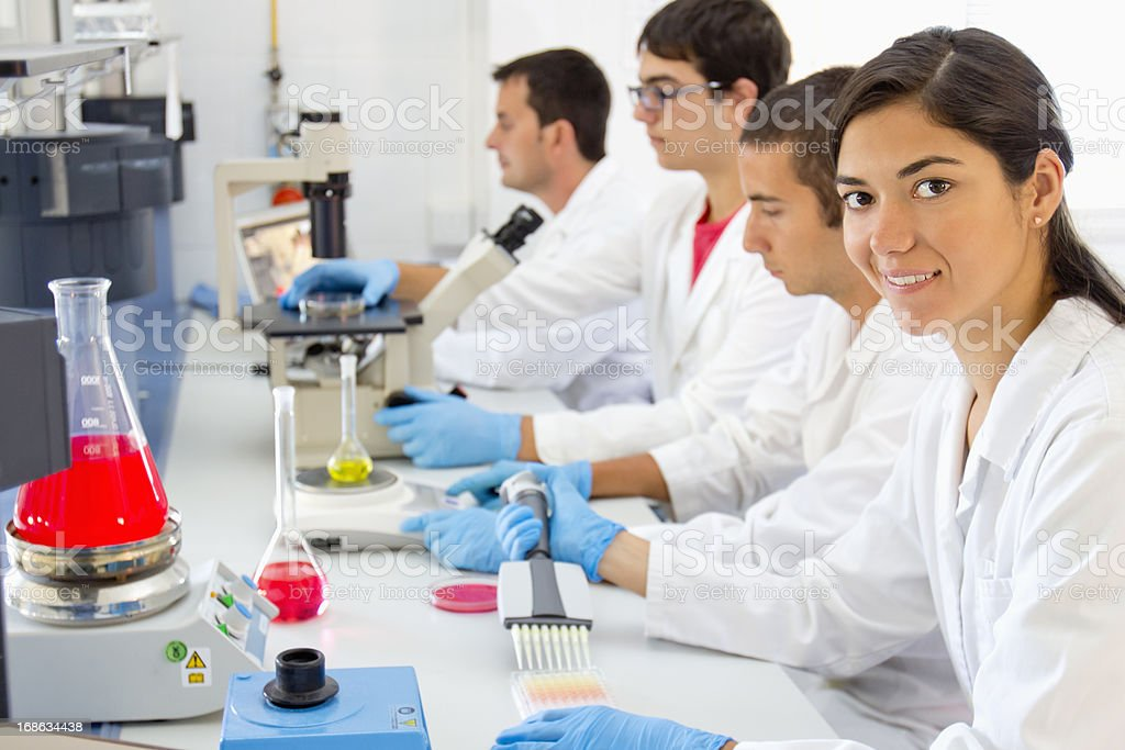 Research team at a pharmaceutical laboratory royalty-free stock photo