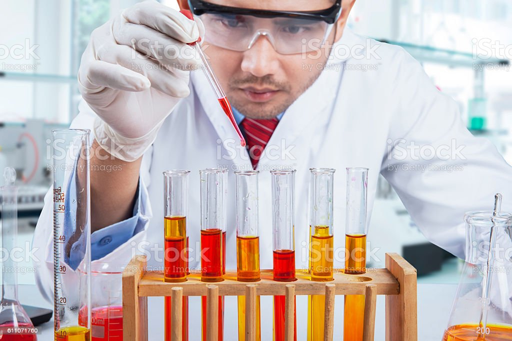 Research worker doing chemical test stock photo