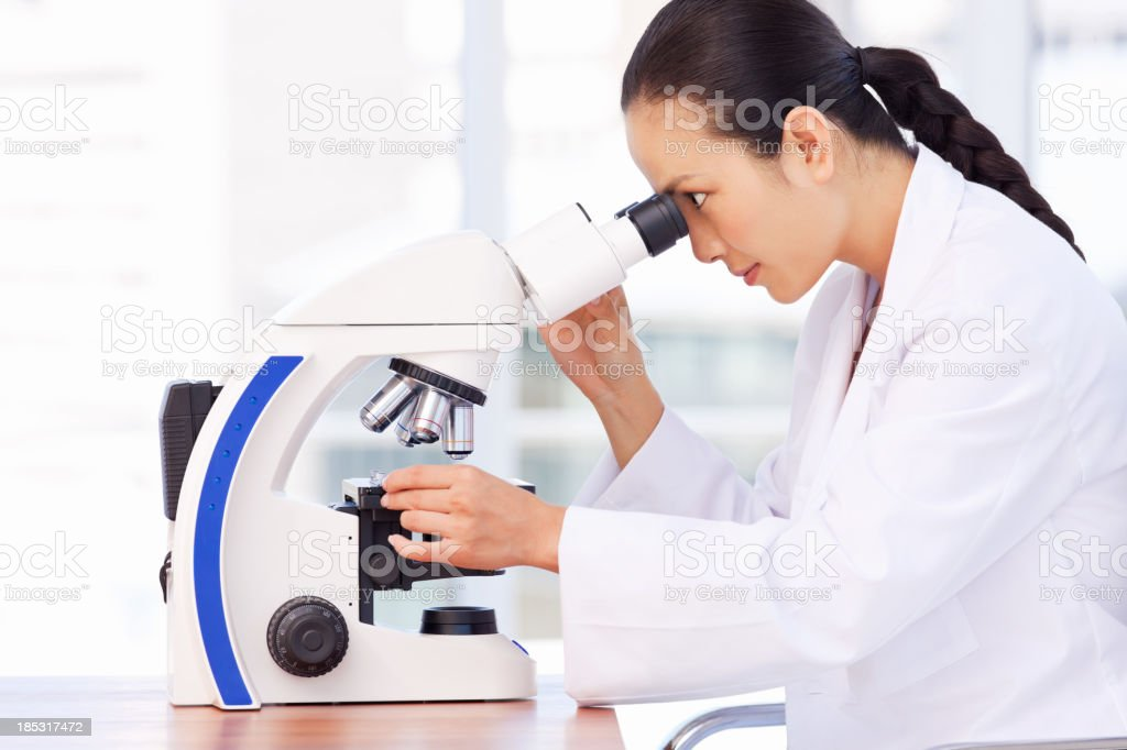 Researcher Analyzing Biopsy Samples. stock photo