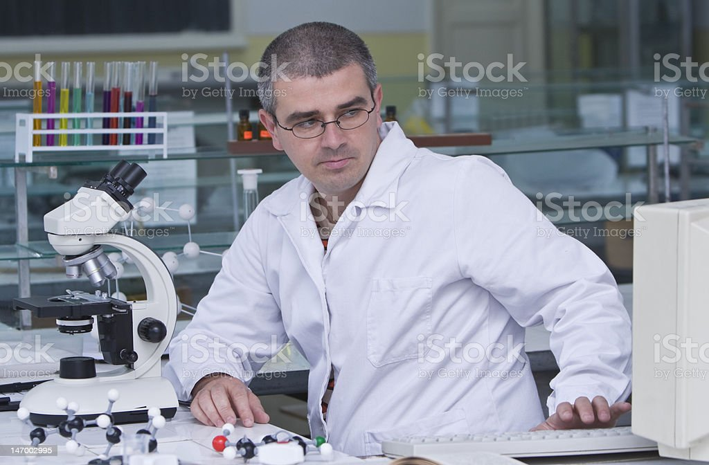 Researcher at his workplace royalty-free stock photo