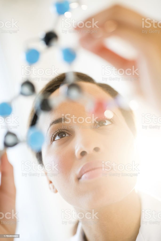 Researcher Examining Molecular Structure In Laboratory royalty-free stock photo