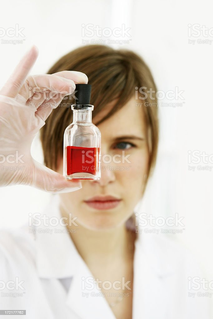 Researcher holding a test tube royalty-free stock photo