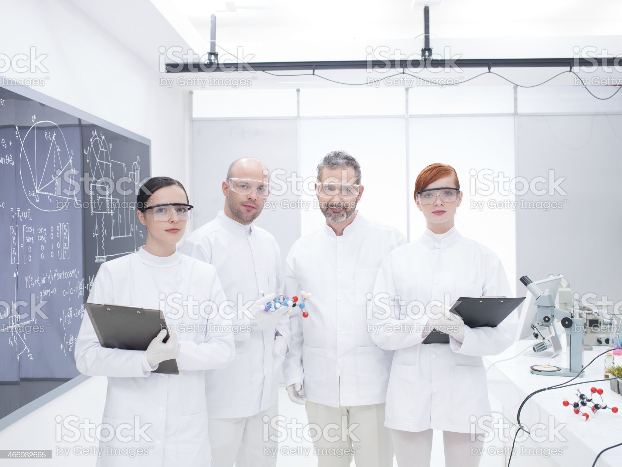 researcher team in laboratory royalty-free stock photo