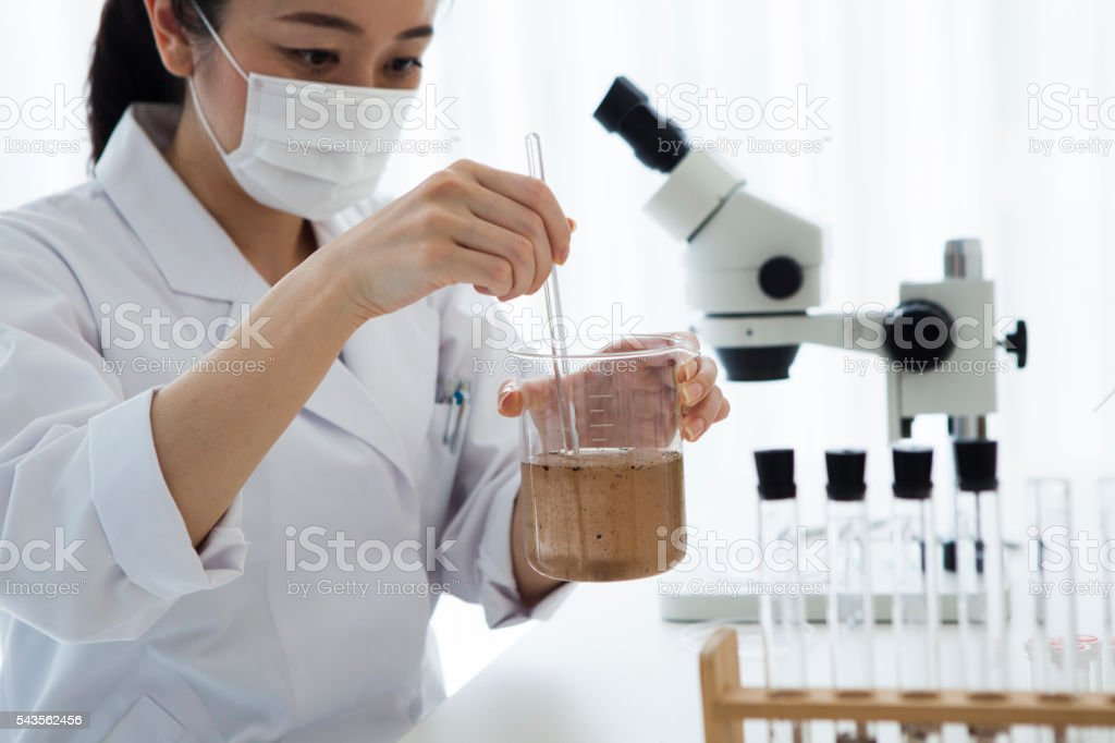 Researcher that the investigation of the muddy water stock photo