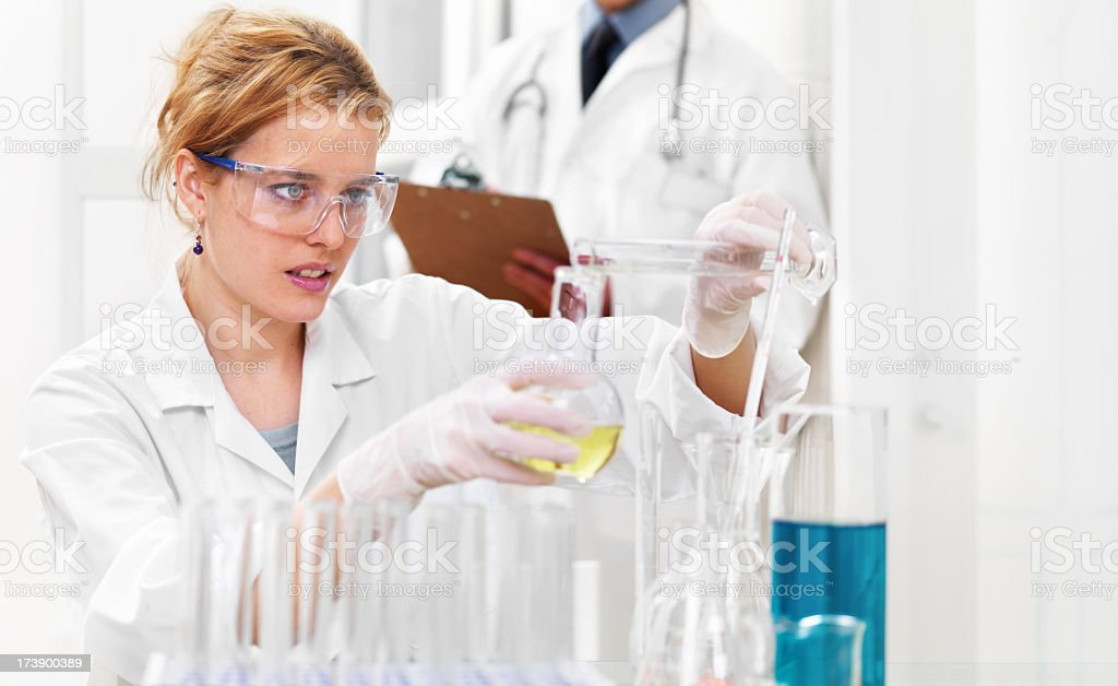 Researcher with chemicals royalty-free stock photo