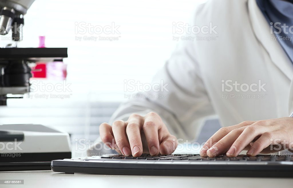 Researcher working at computer stock photo