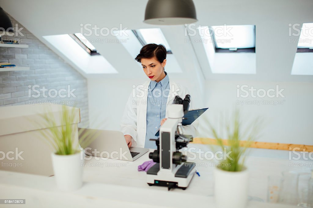 Researcher Working In Her Lab. stock photo
