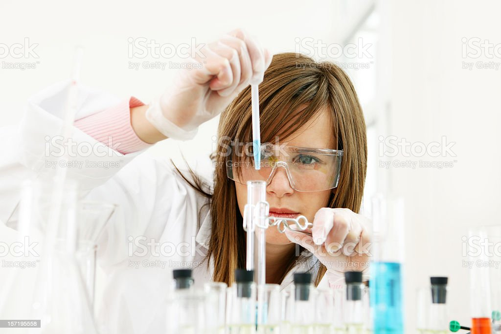 Researcher working with chemicals royalty-free stock photo