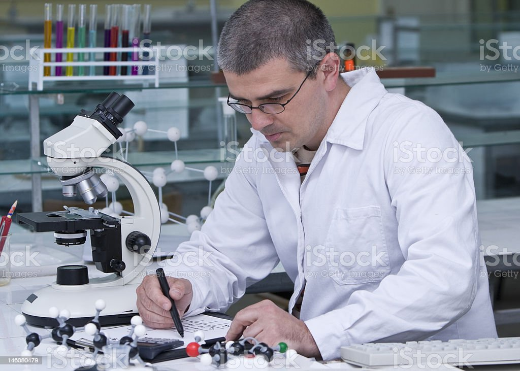 Researcher writing royalty-free stock photo