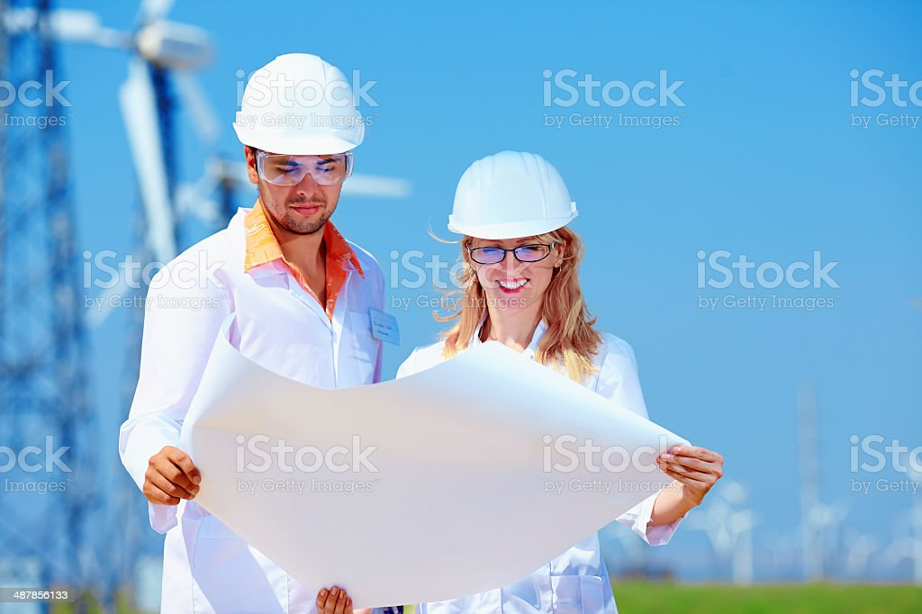 researchers at work  on wind power station stock photo
