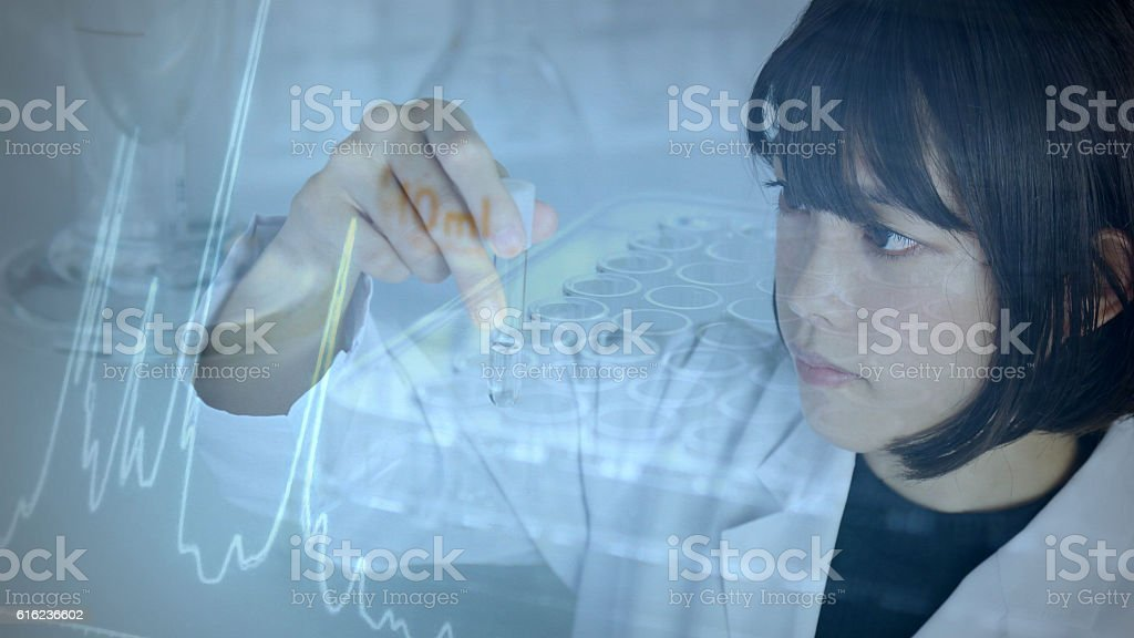Researchers who stare at the test tube stock photo