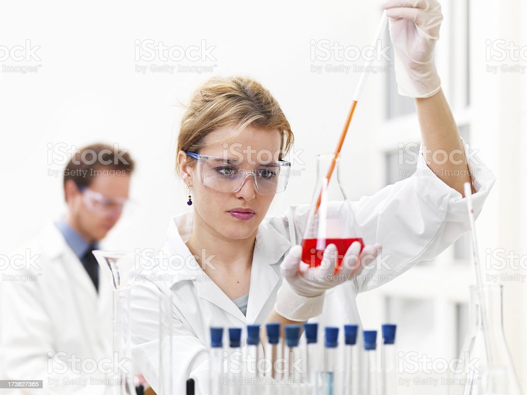 Researchers working with chemicals royalty-free stock photo