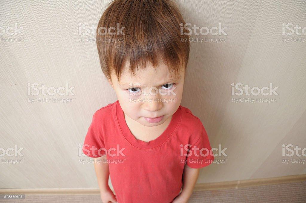 resentful boy underarm stock photo