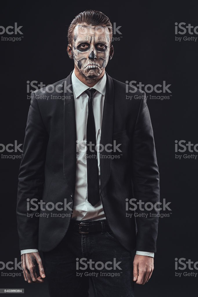resentful businessman with a makeup the skeleton stock photo