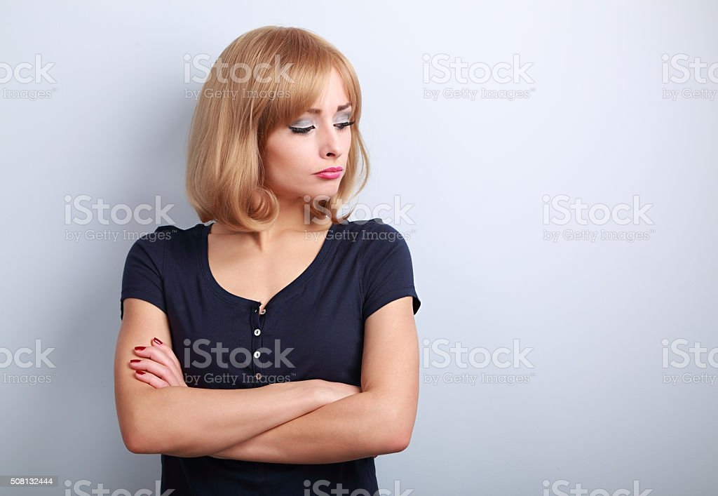 Resentful unhappy casual woman with short blond hair looking stock photo