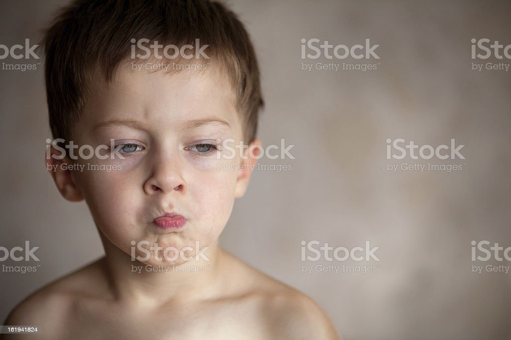 Resentment of a little boy royalty-free stock photo