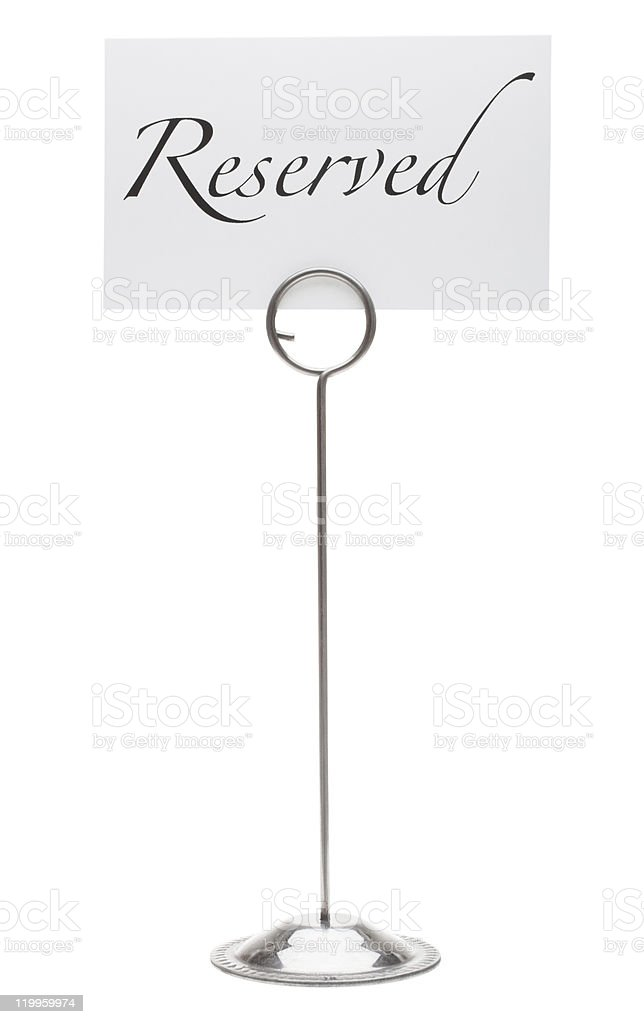 Reservation sign in card holder stand stock photo