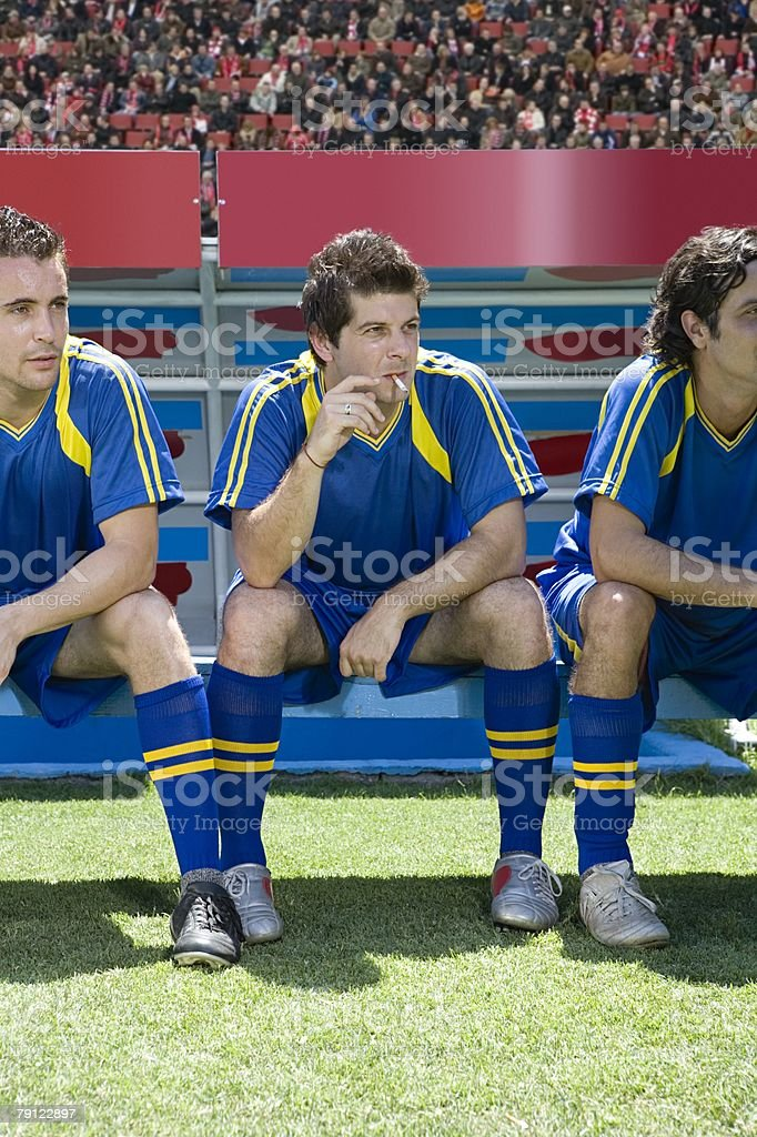 Reserve footballer smoking a cigarette stock photo