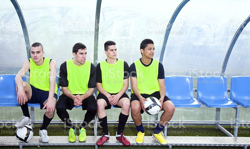 Reserve soccer players on the bench stock photo