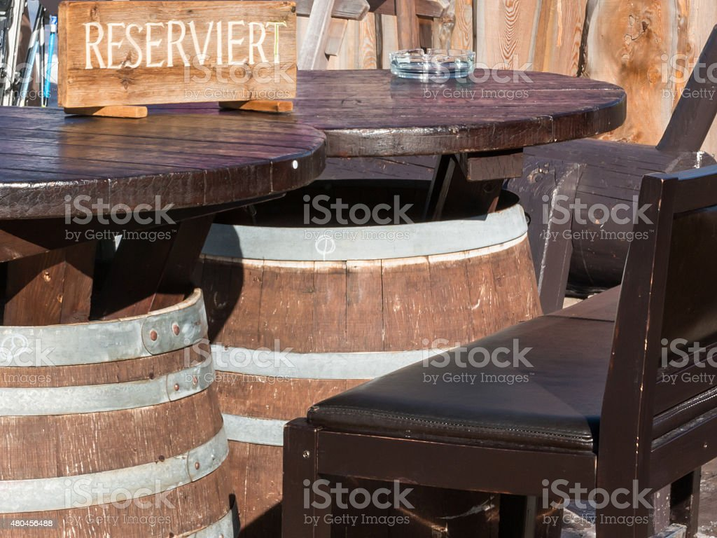 Reserved barrel shaped table in mountain chalet stock photo