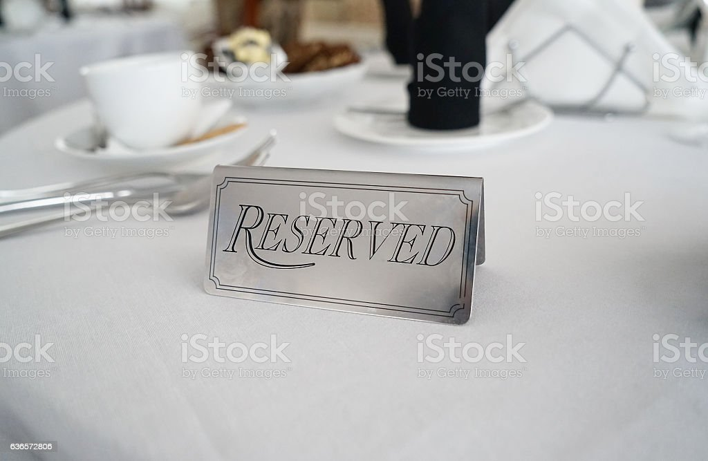 Reserved label on the white tablecloth stock photo