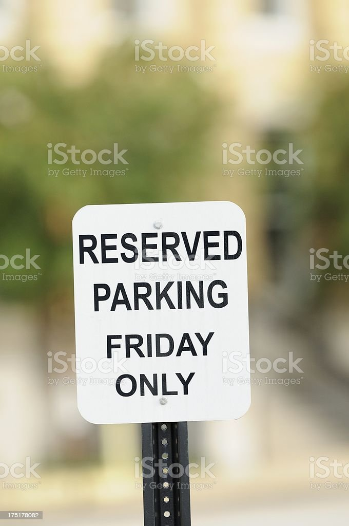 Reserved parking Friday only sign close up royalty-free stock photo