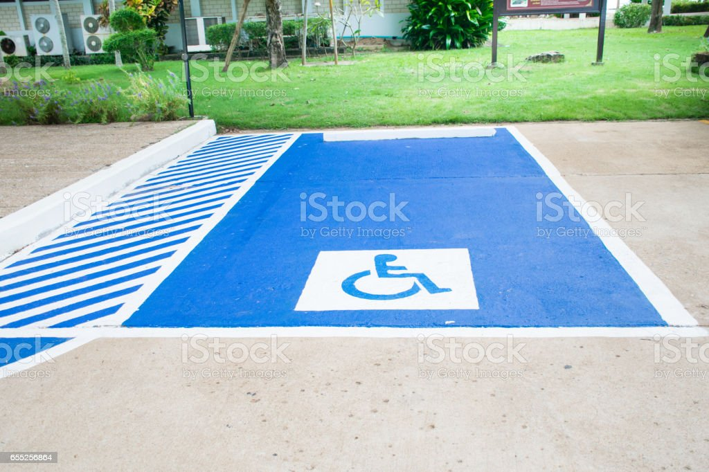 Reserved parking lot for facilities the disabled on blue and white stock photo