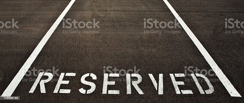 A reserved parking painted in white  stock photo