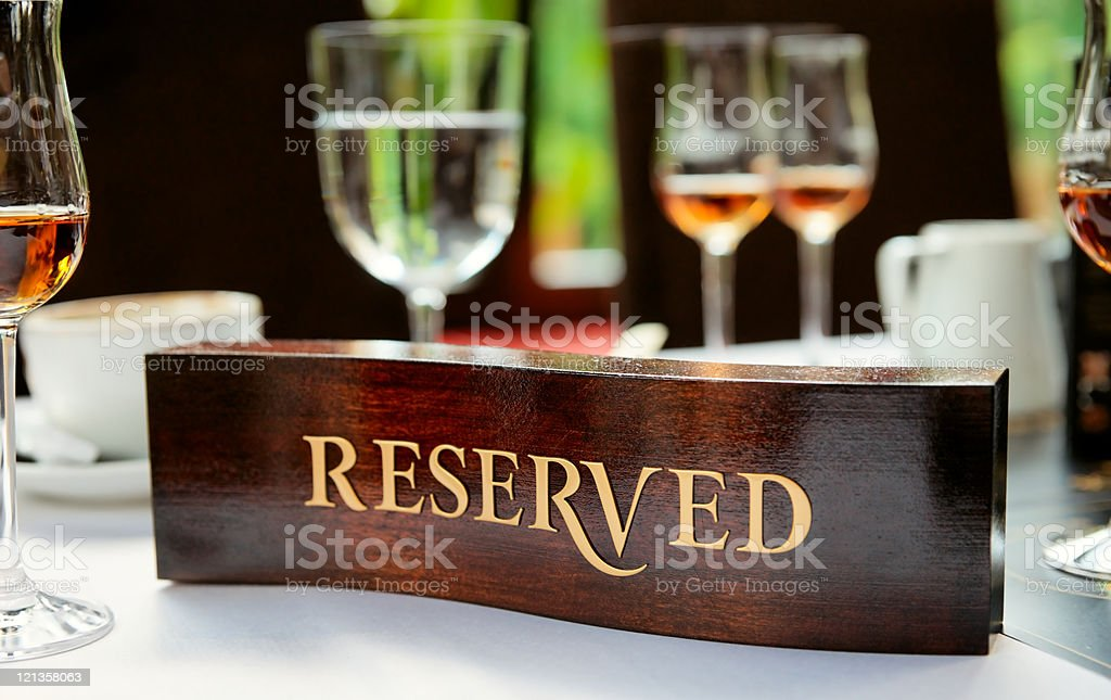 Reserved plate on a restaurant table royalty-free stock photo