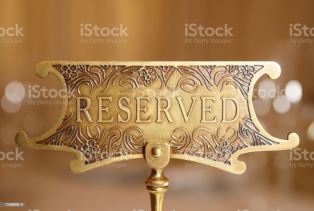 Reserved plate on restaurant table stock photo
