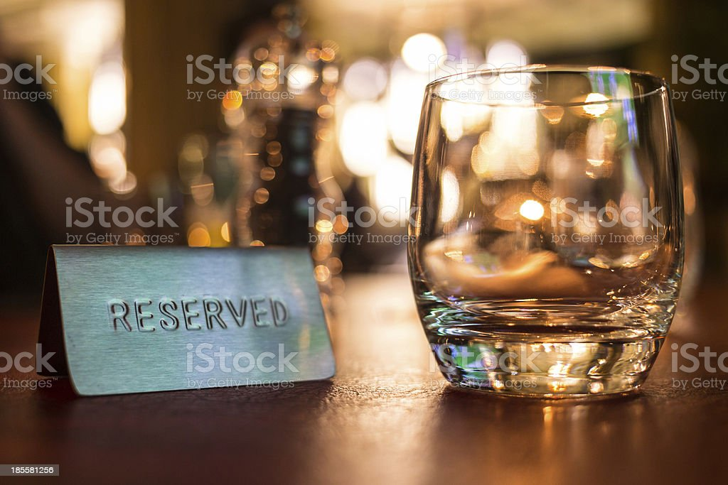 Reserved sign next to a tumbler glass stock photo