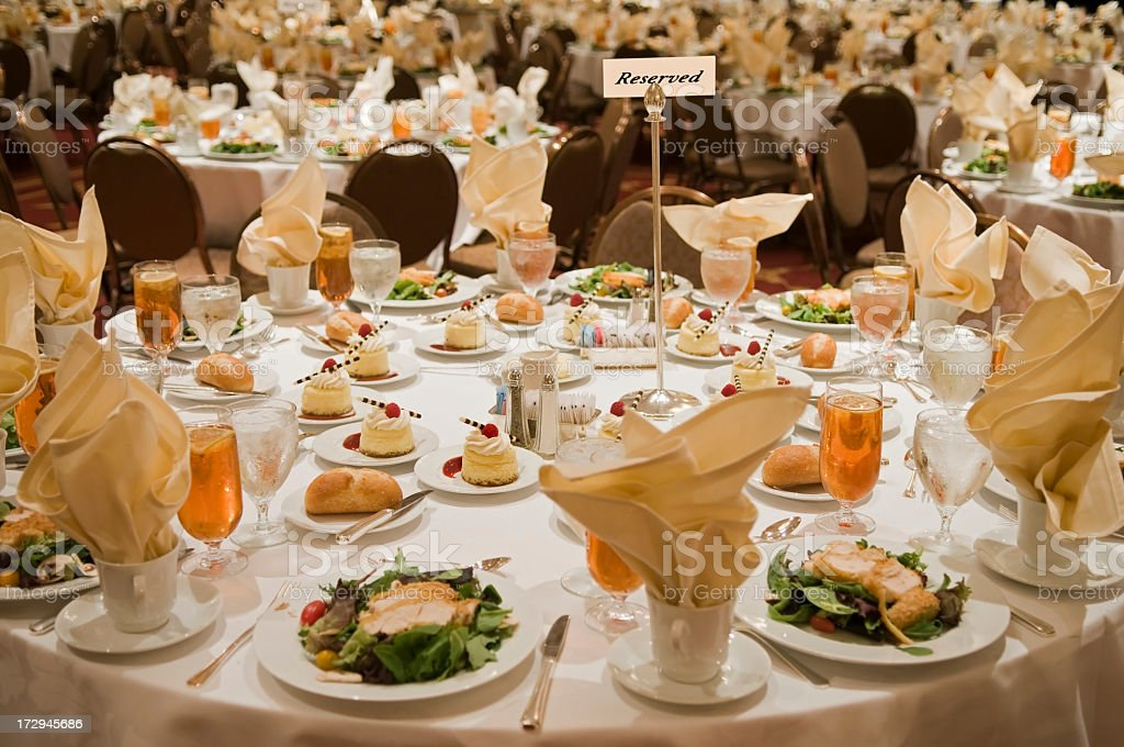 Reserved sign on a large, set banquet table stock photo