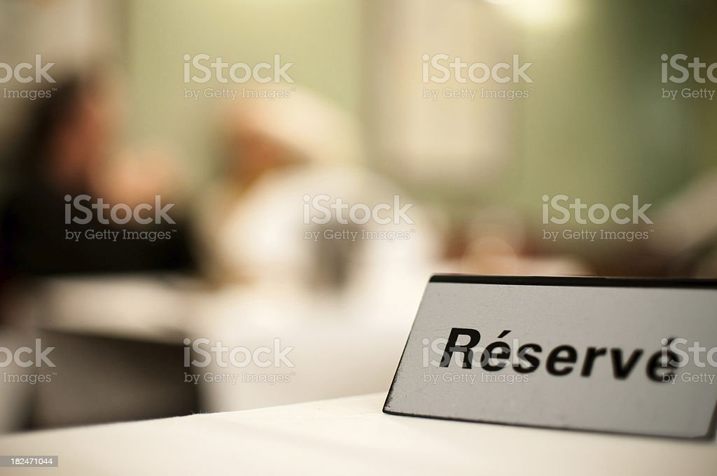 reserved sign on a restaurant table stock photo