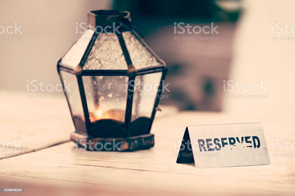 Reserved sign on outdoor restaurant table stock photo
